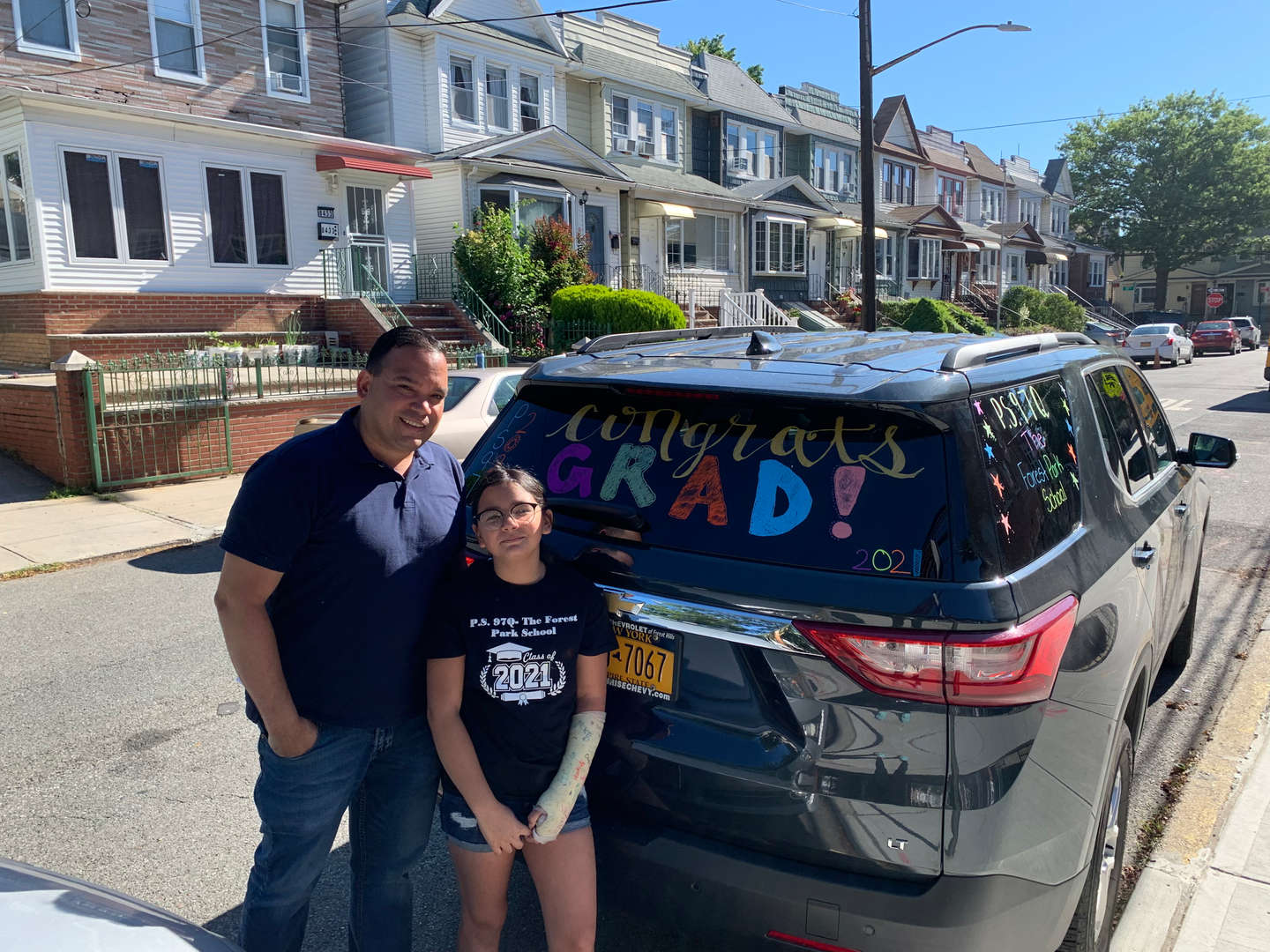 Student and dad ready for Grade 5 car parade.
