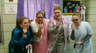 Four teachers dressed as old women