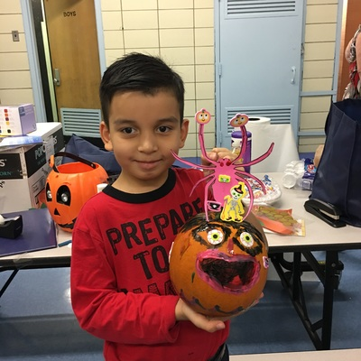 Boy with his colorful pumpkin