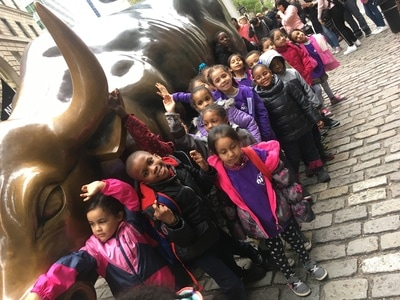 Students gathered around the Charging Bull