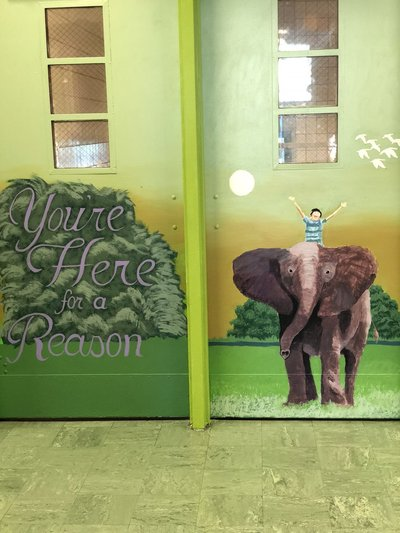 A painting of a child on an elephant on doors