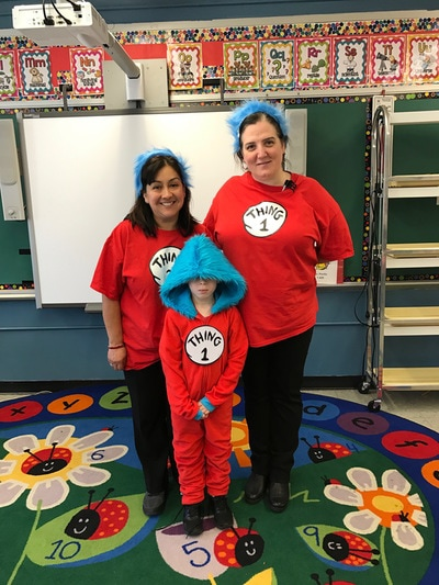 Teachers and student dressed as Thing 1