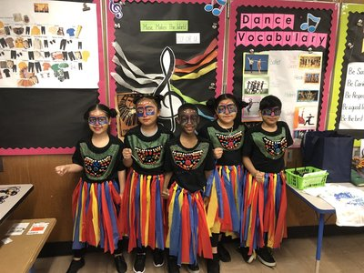 Five students dressed in costume for The Lion King