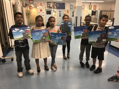 Six students holding up their paintings