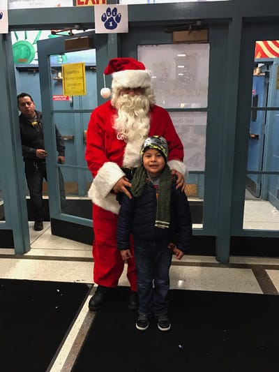 Student posing with Santa