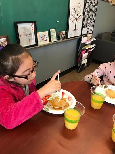 Girl eating pancakes