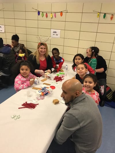 Students and parents building with candy