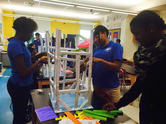 Students building a structure in the classroom