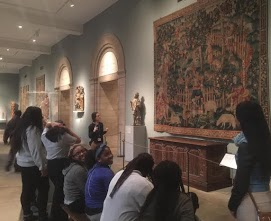 Students viewing an art piece at the museum
