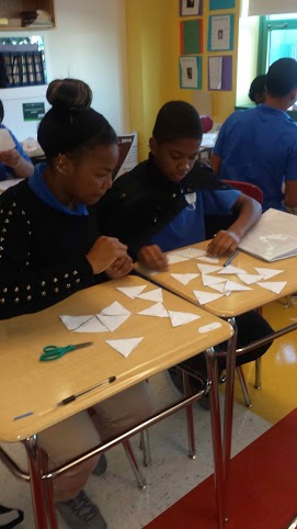 Students counting paper shapes