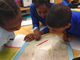 Students examining a map