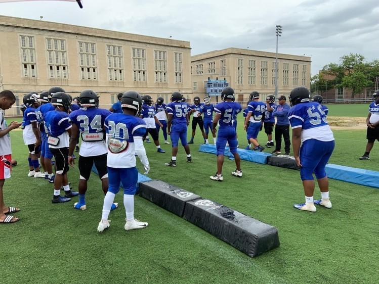 Students on football team