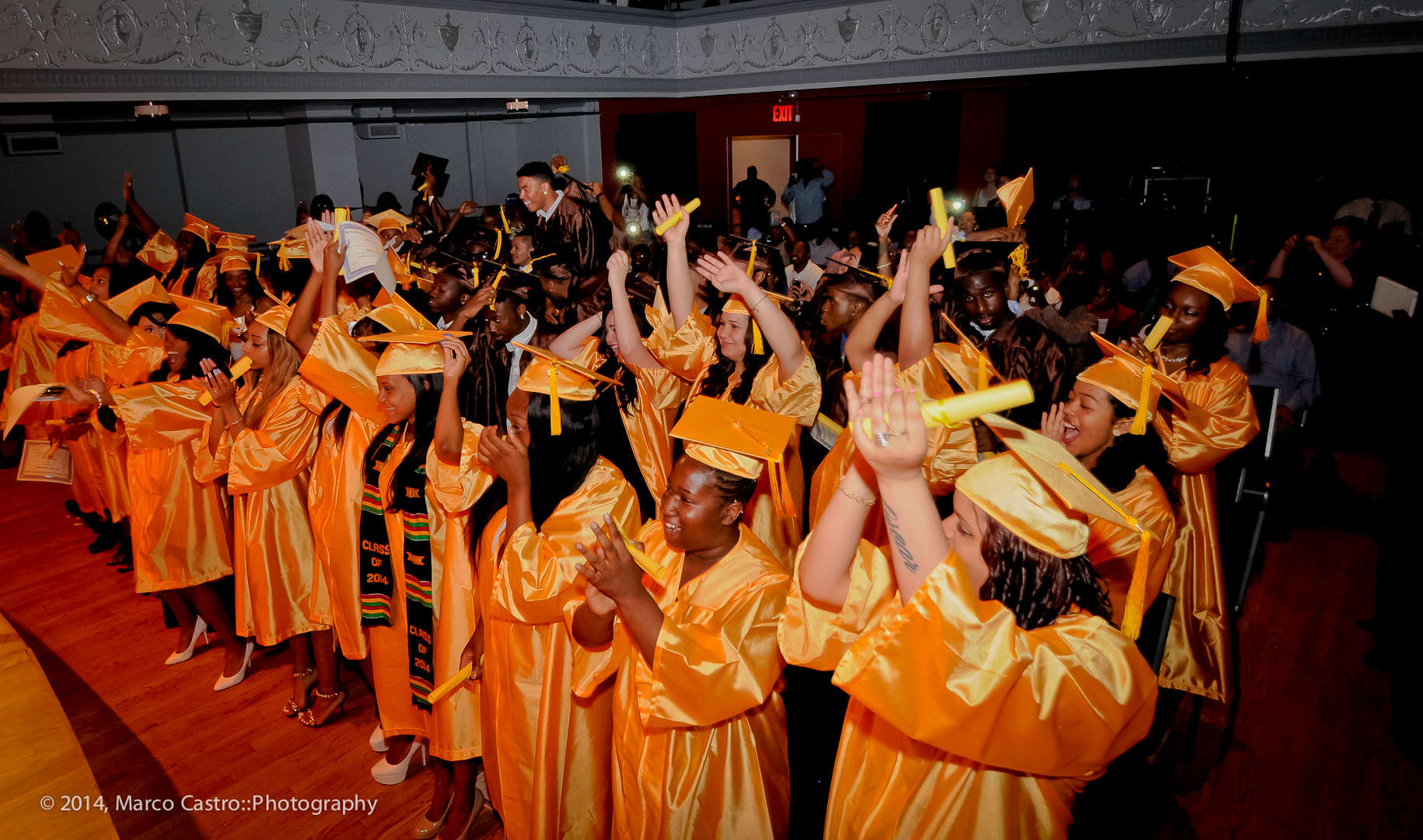 Graduates in yellow caps and gowns