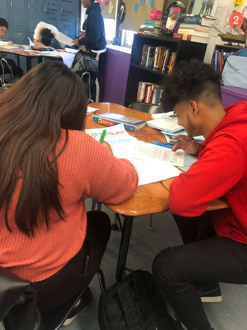 Students working on paper together