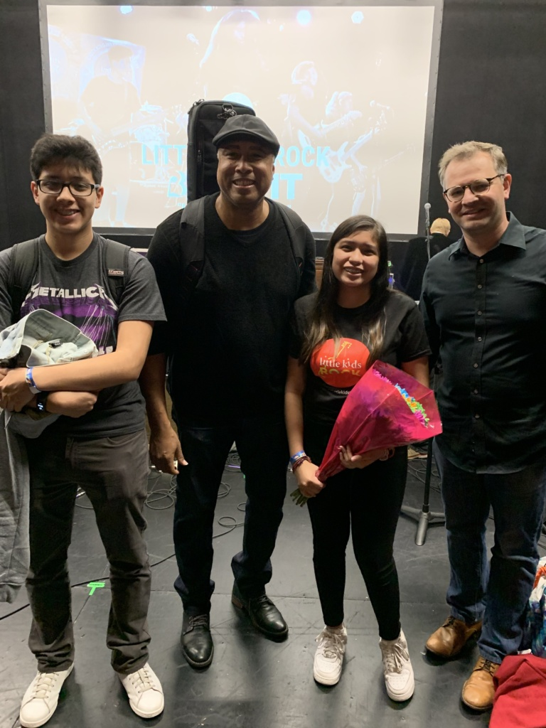 Two students with two teachers at the Little Kids Rock concert backstage
