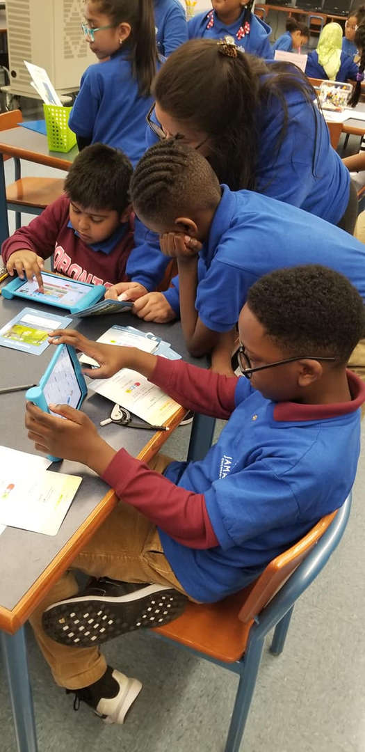 JCS students using technology to complete task