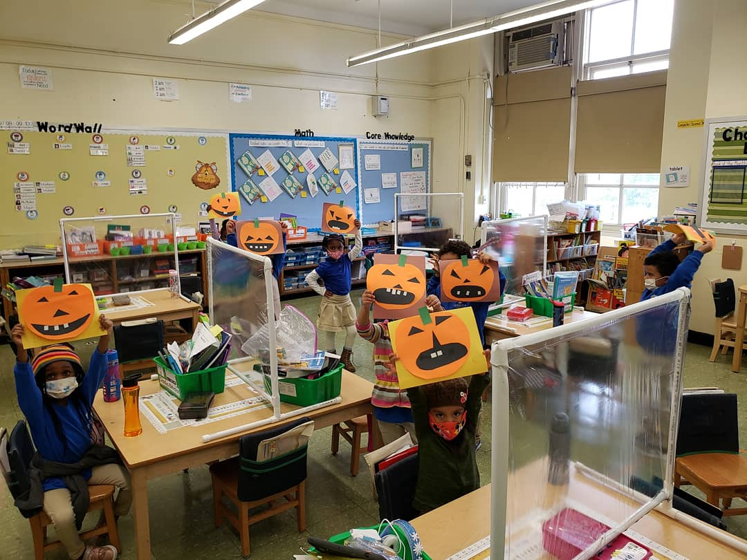 Students showing their jack-o-lanterns