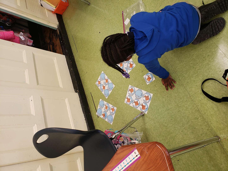 Kindergarten student sequencing letters