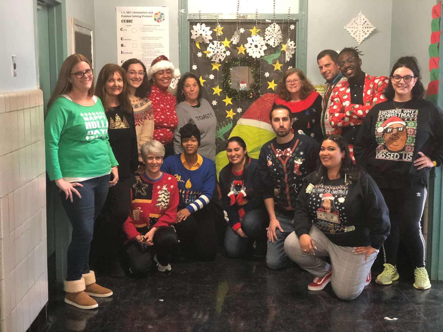 IS 381 Staff in their Holiday sweaters