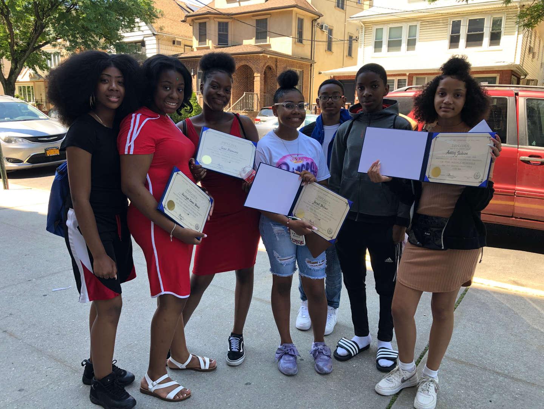 2020 Graduates proudly display their diplomas