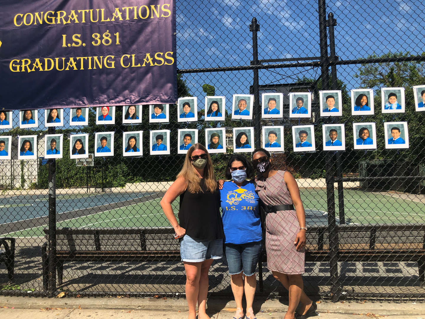 Principal Agard, Ms. O'Leary and Ms. Levenberg pose in front of our Wall of Graduates