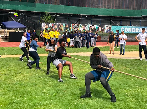 IS 381 Students facing the Staff in Tug Of War