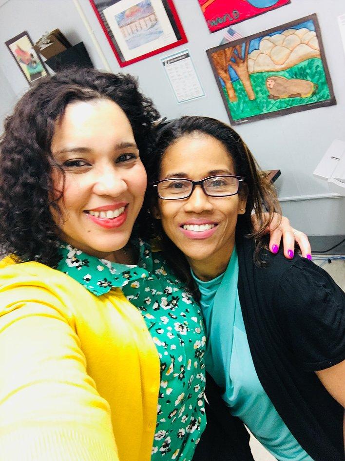 Principal Erica Ureña-Thus with her arm around a teacher