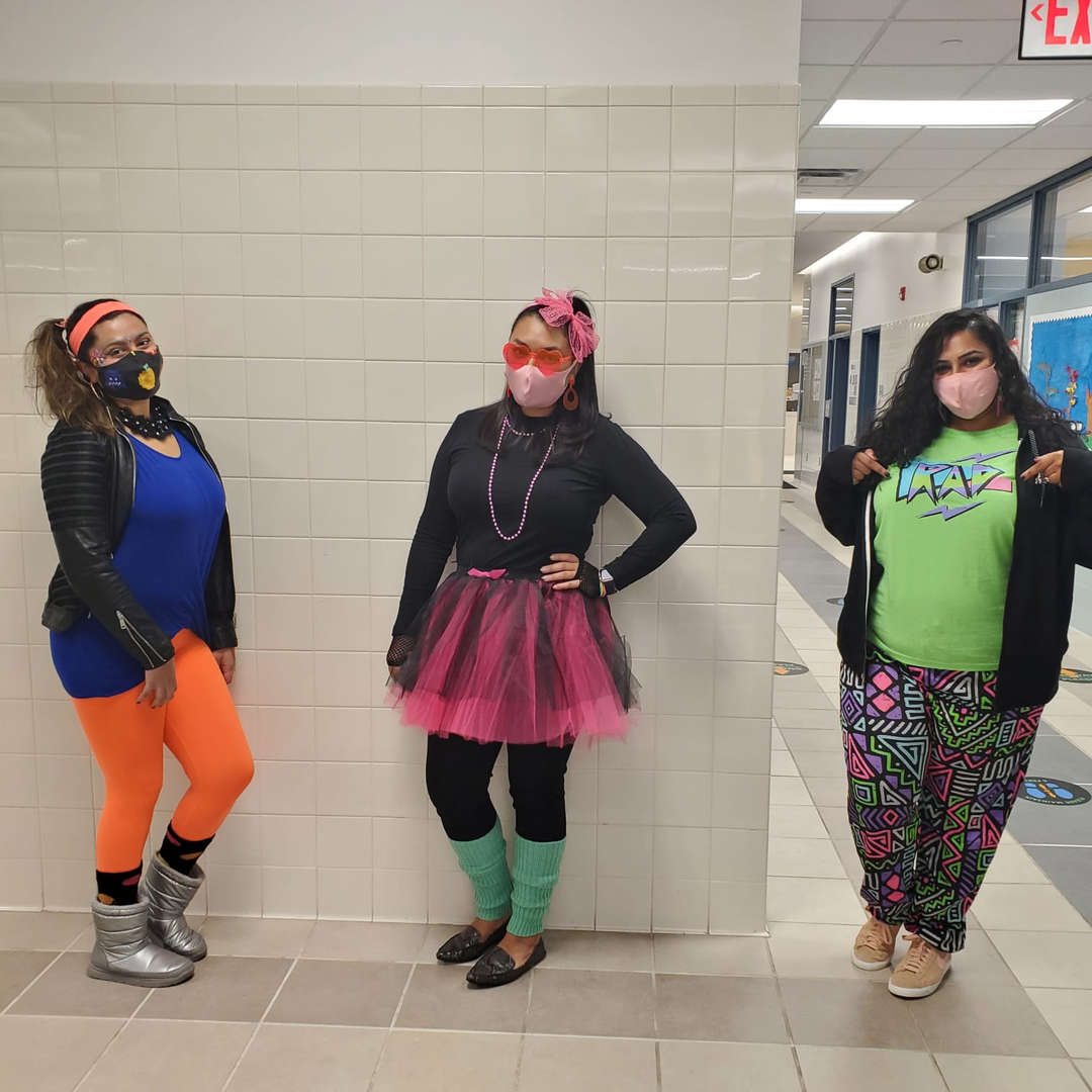 Teachers dressed up during spirit week throwback day