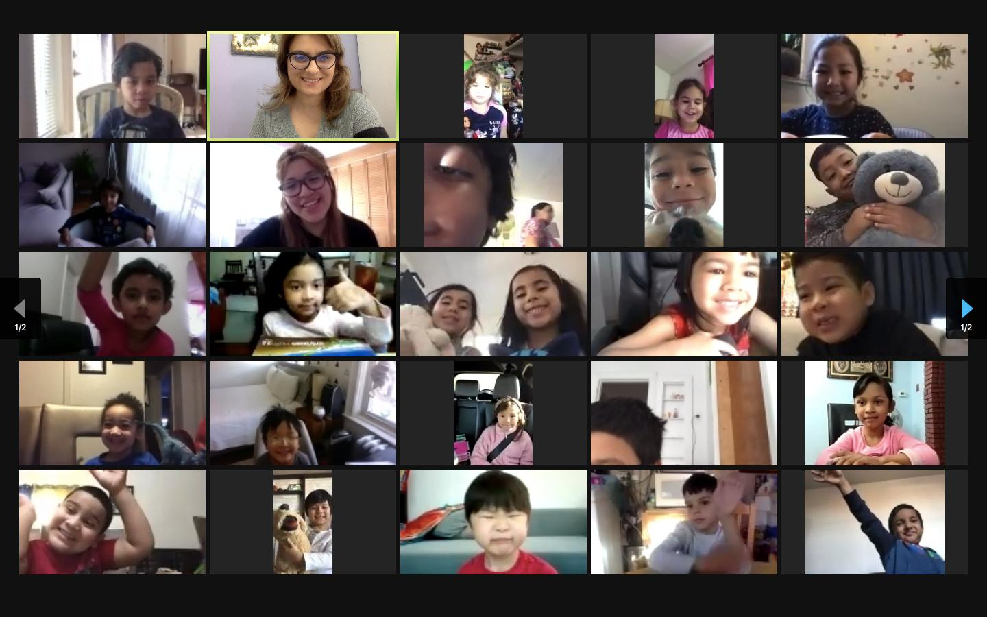 Students and teachers smile on a Friendsgiving Zoom call