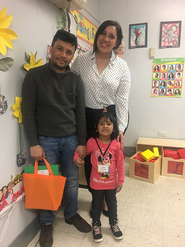 Principal Erica Ureña-Thus with a student in pink and her parent