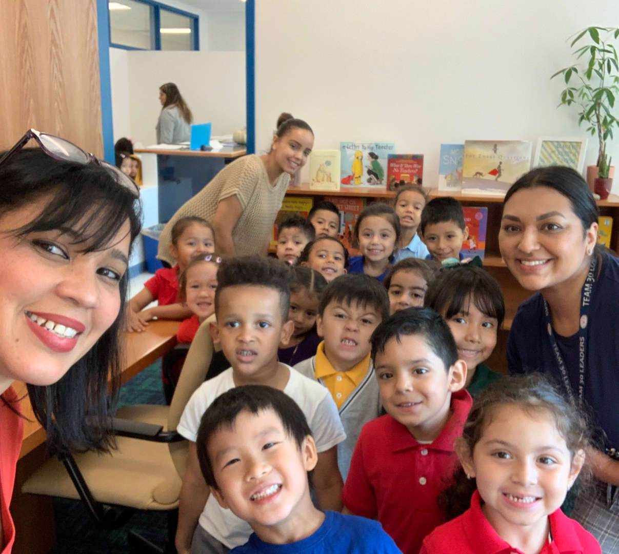 Principal Urena Thus with teachers and students from PreK