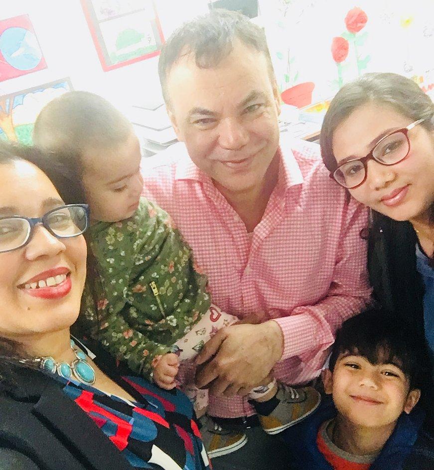 Principal Erica Ureña-Thus with a family in the classroom