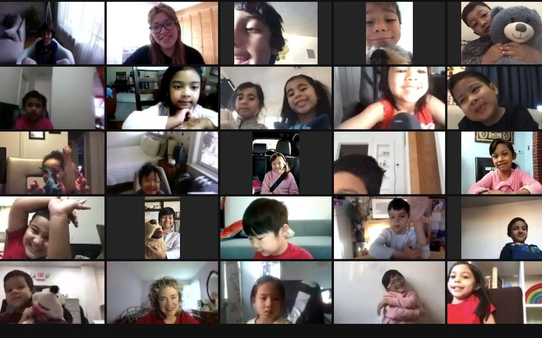Students listen attentively to their teachers and classmates on a Friendsgiving Zoom call