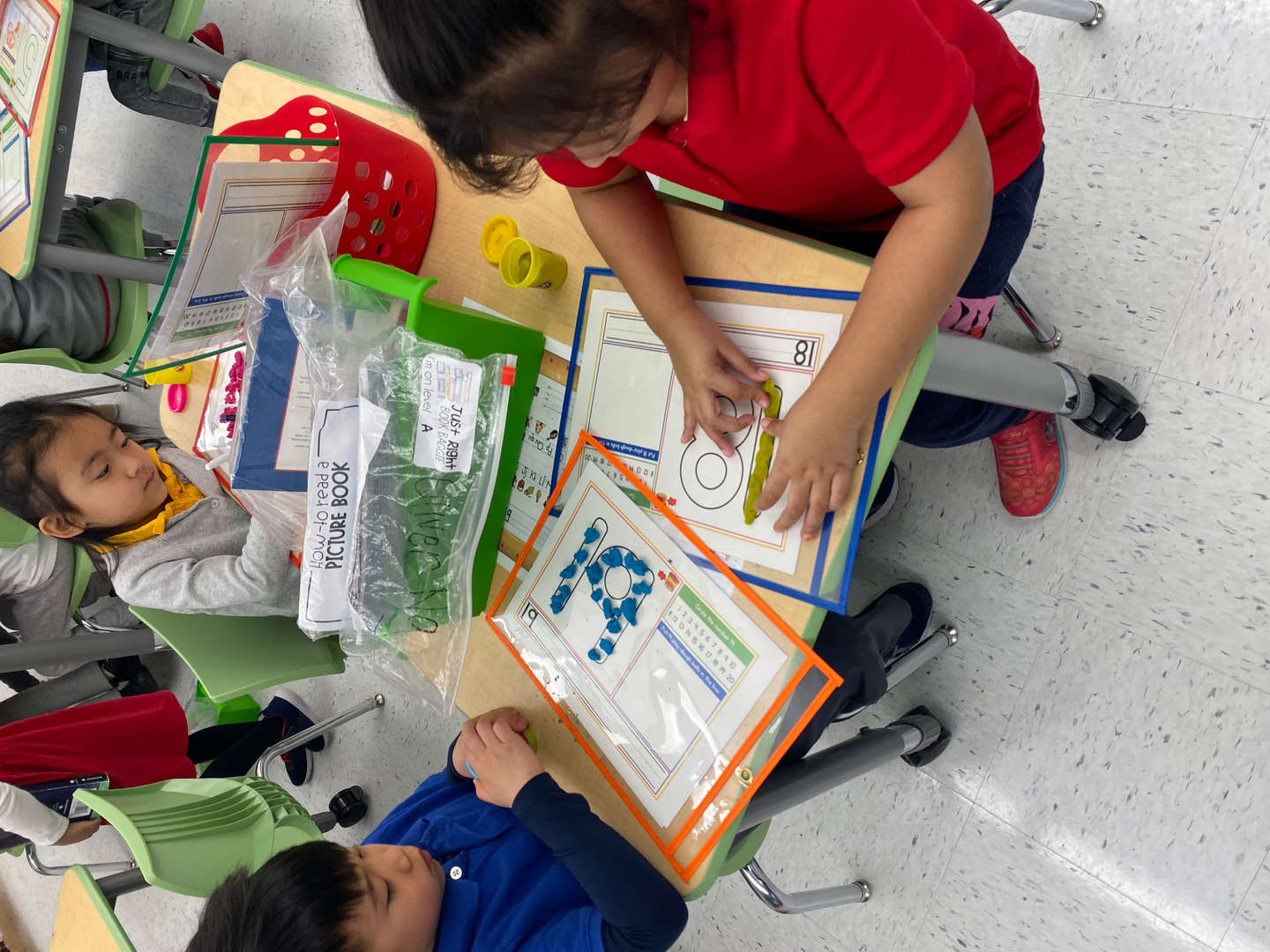 Students engaging in center time at their desks