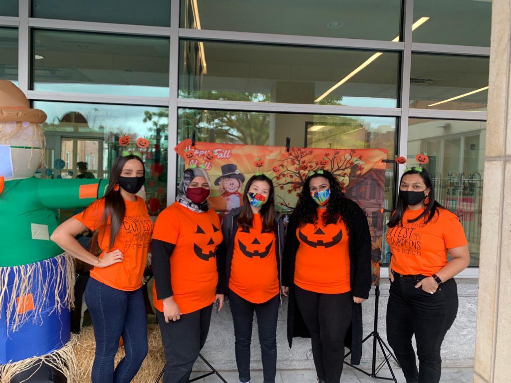 Teachers dressed up as pumpkins for Halloween