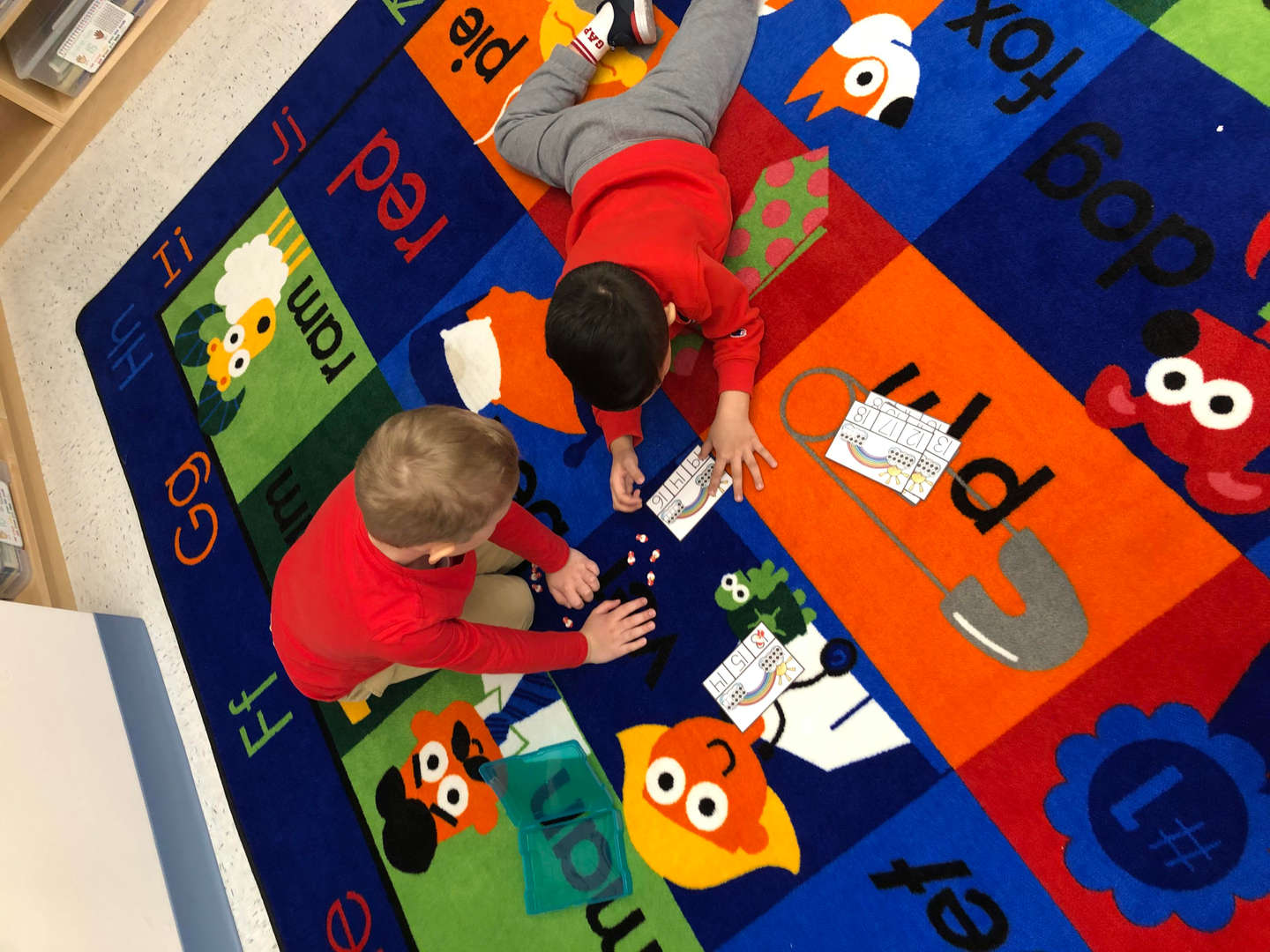 Students engaging in center time on the carpet area
