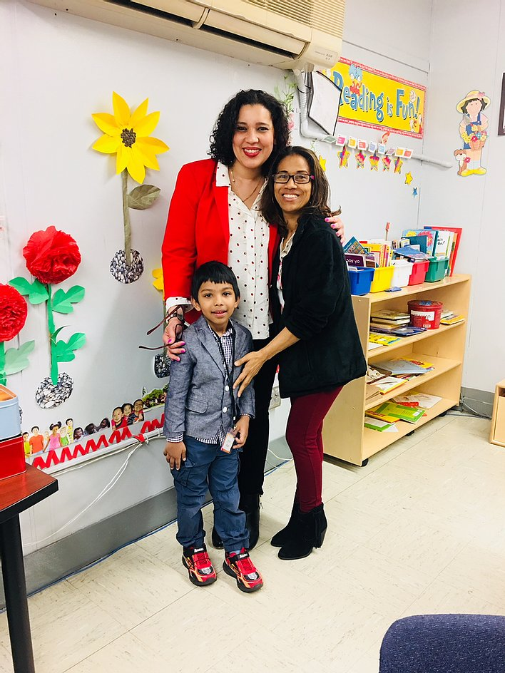 Principal Erica Ureña-Thus with a student and his parent in the classroom
