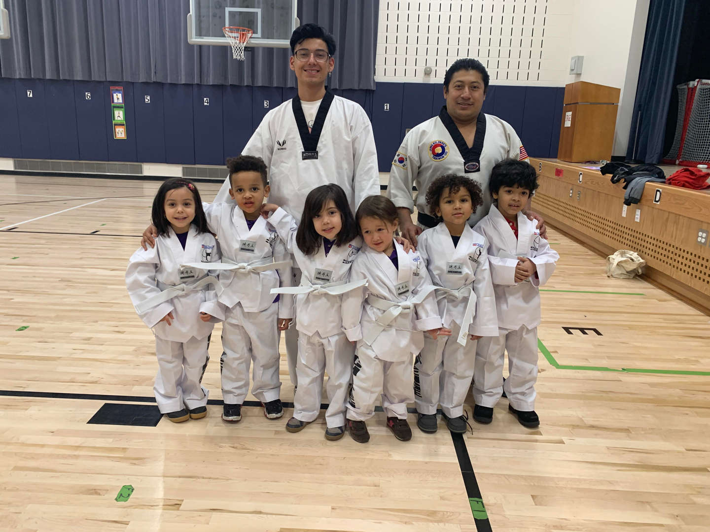 Students and instructors learning about karate