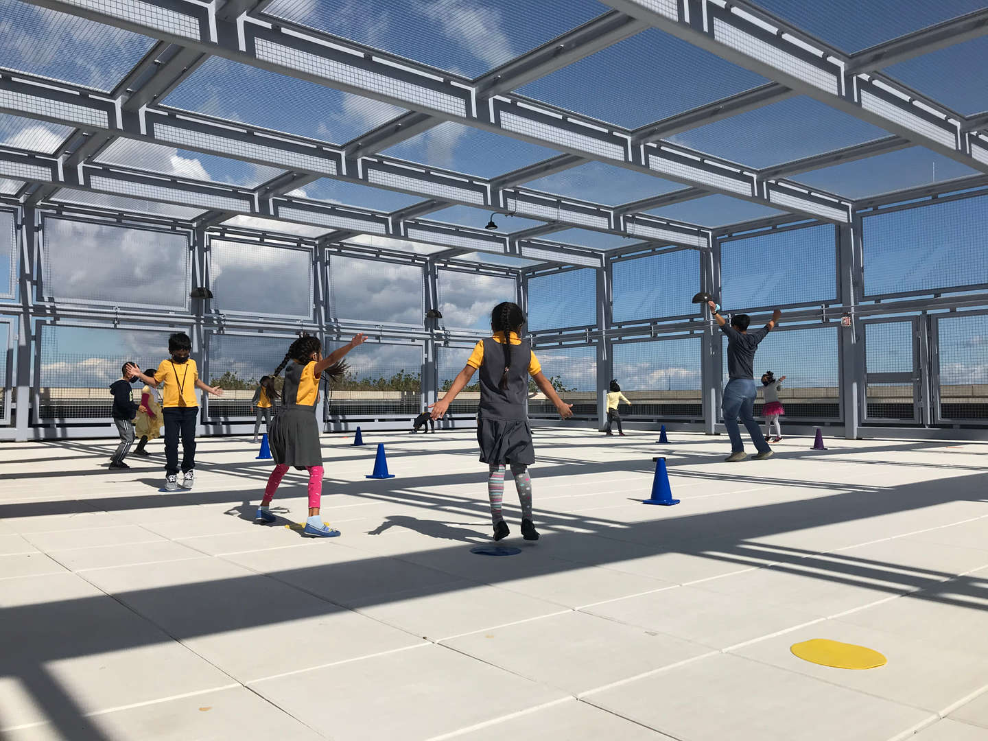 Students playing gym on our outdoor rooftop