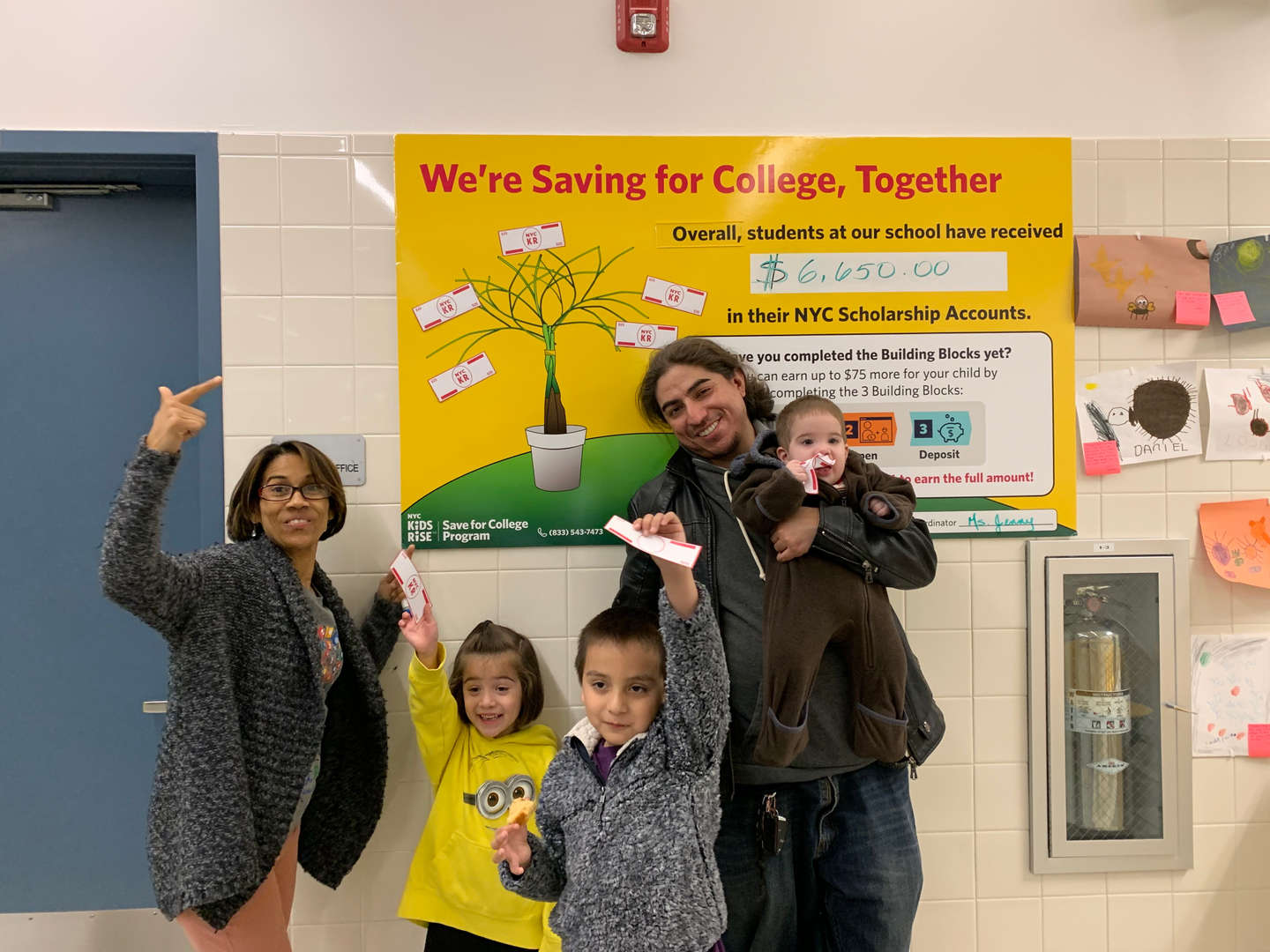 Teacher, parent and students learning all about saving for college