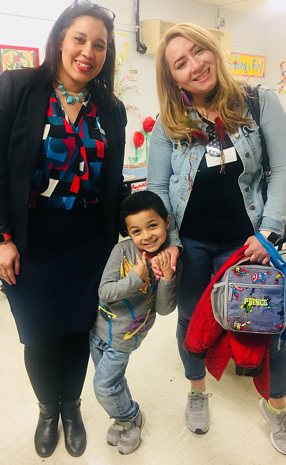 Principal Erica Ureña-Thus with a student in gray and his parent