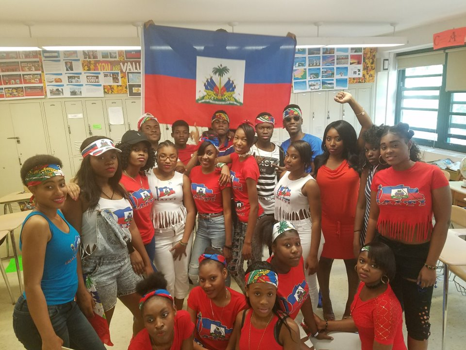 Students wearing outfits in matching colors honoring Haiti