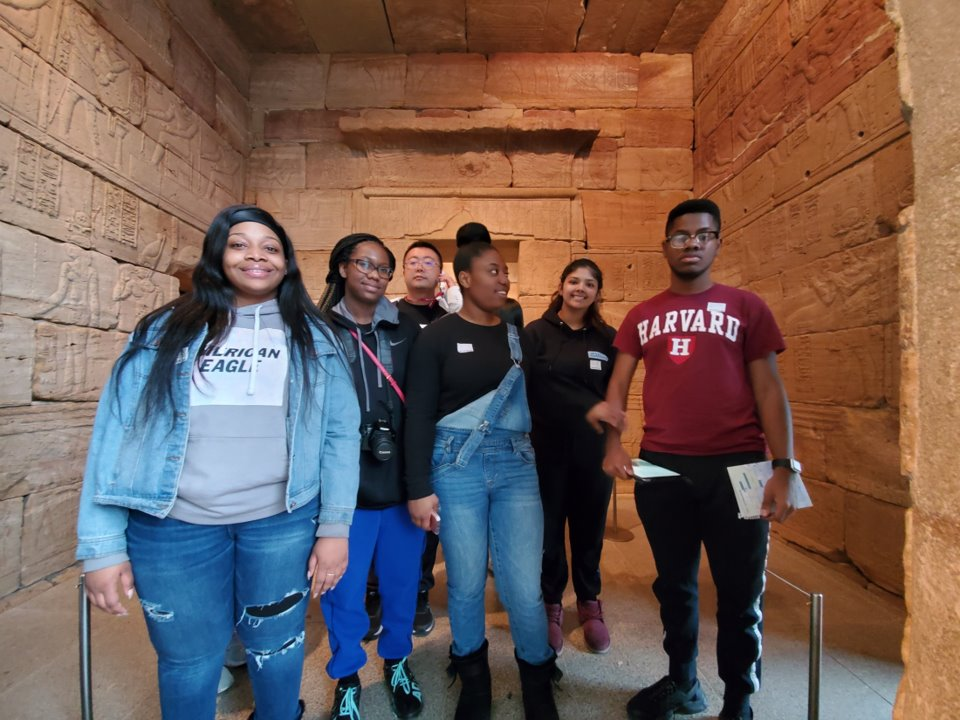 Students standing in an Egyptian museum exhibit