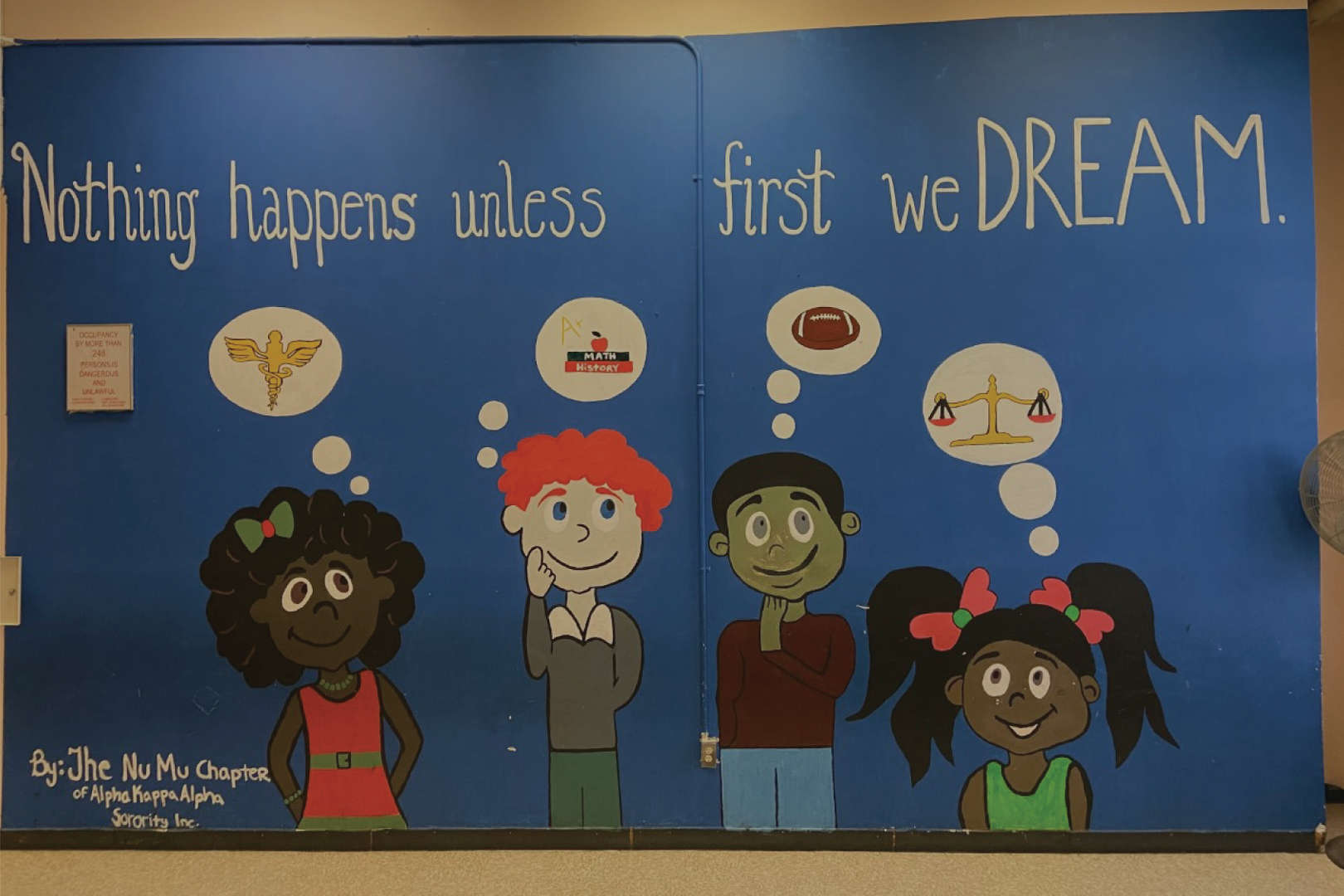 Nothing happens unless first we DREAM mural