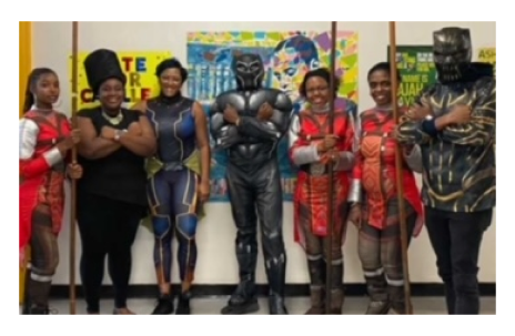 Staff in costumes from Black Panther