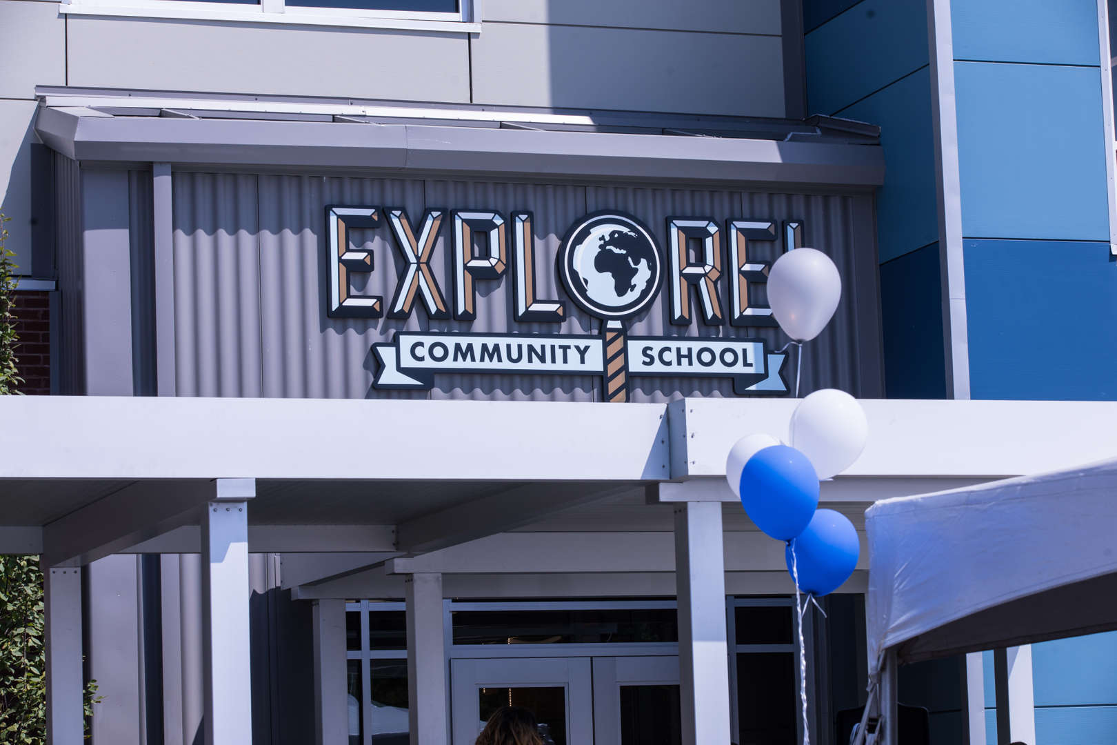 Explore! Community School signage on a school building