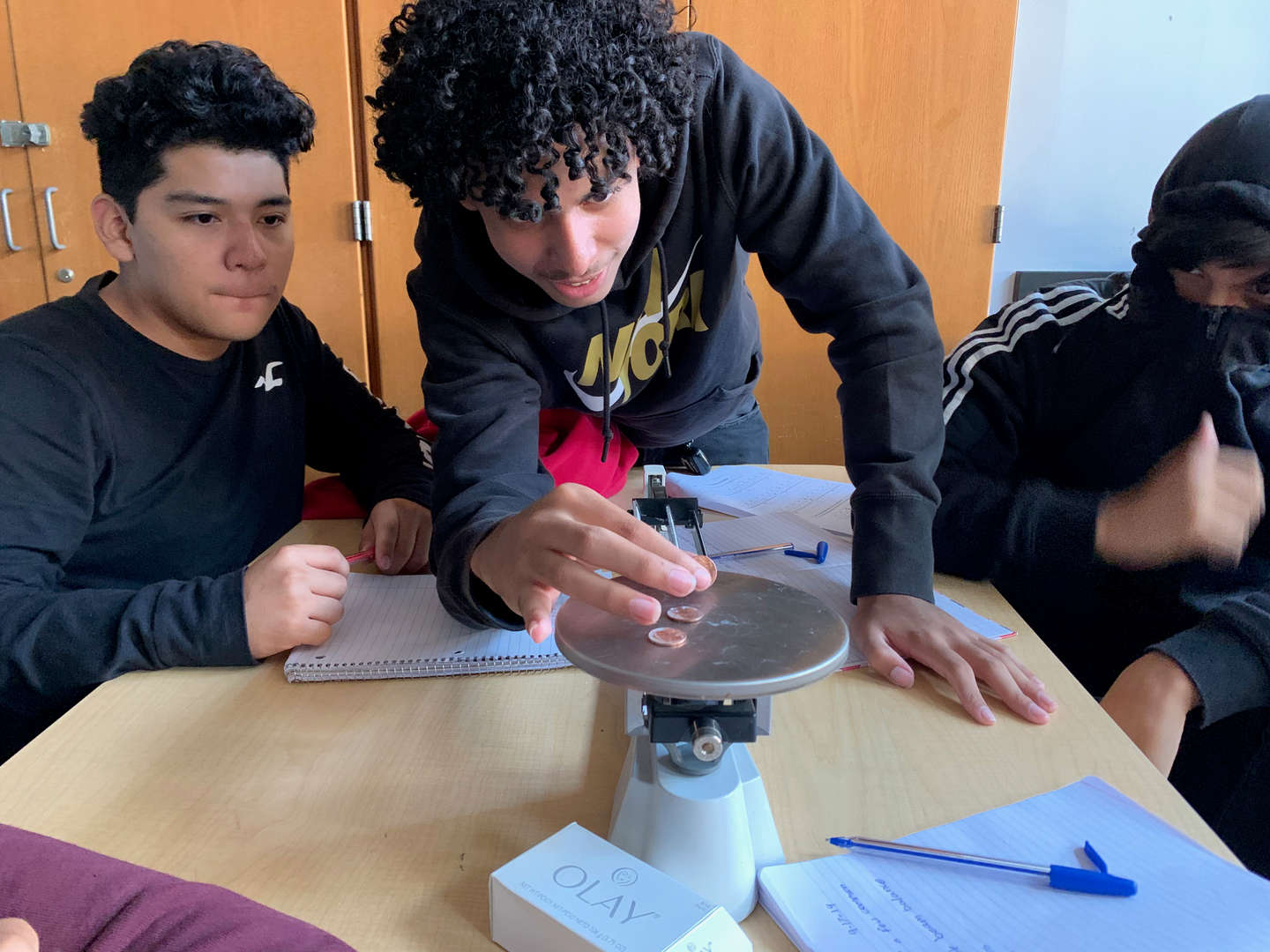 Students calibrate a scale in class