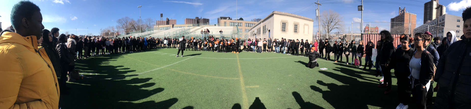 Panorama shot of a crowd on the sports field