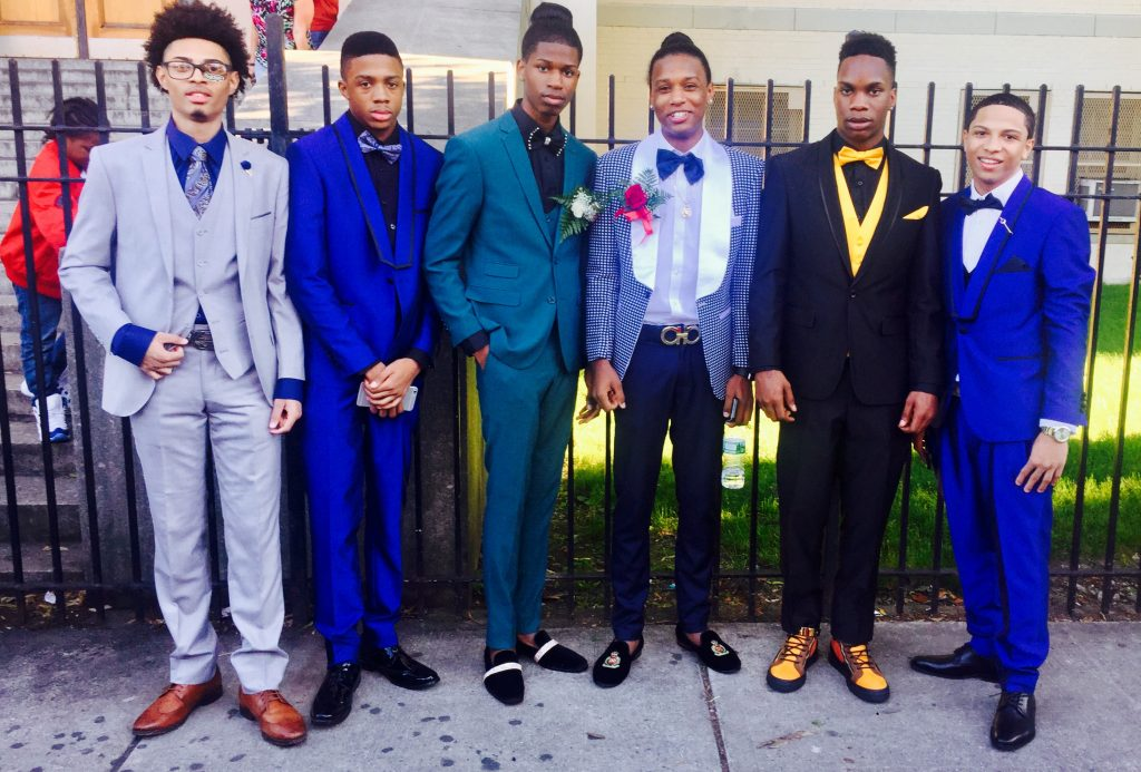 Six students dressed in suits and formalwear for the senior prom