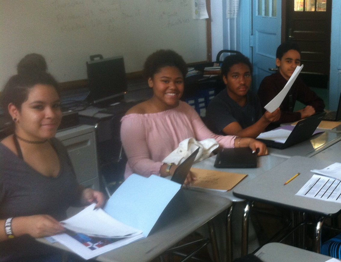 Students looking through their papers in class